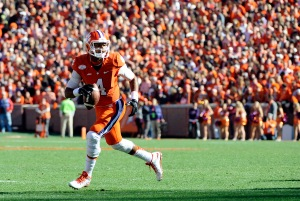 Clemson quarterback Deshaun Watson (4) looks to pass against South Carolina during the first half of an NCAA college football game, Saturday, Nov. 29, 2014, in Clemson, S.C. (AP Photo/Rainier Ehrhardt)